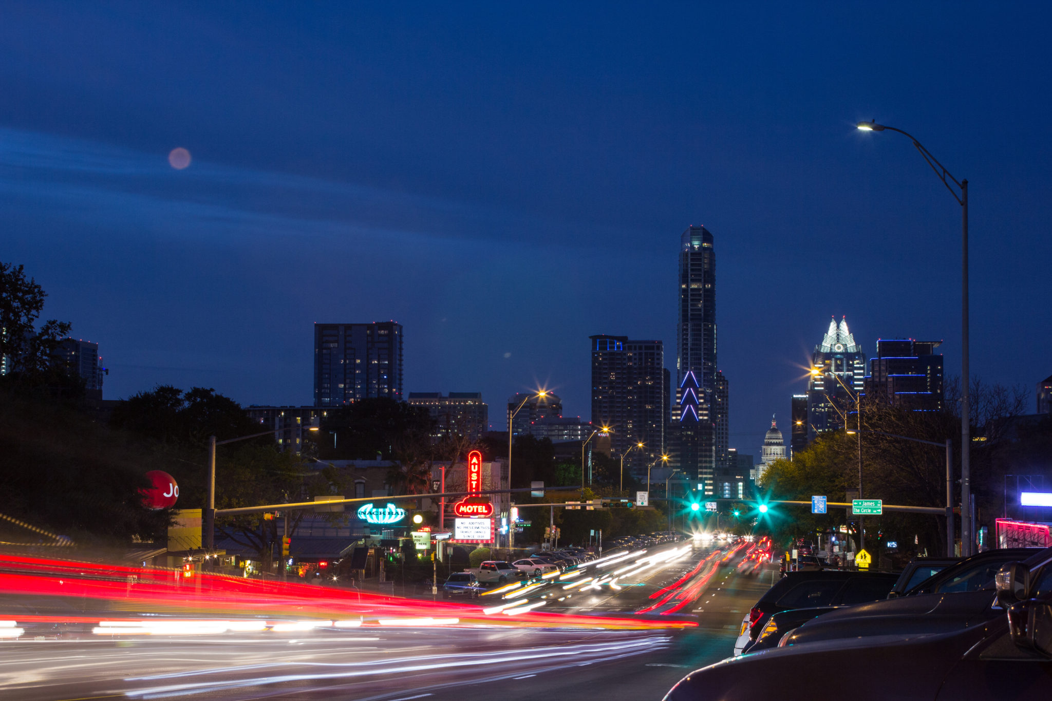 Night photo of South Congress Street in Austin, Texas with red and yellow car lights in the foreground because of the long exposure