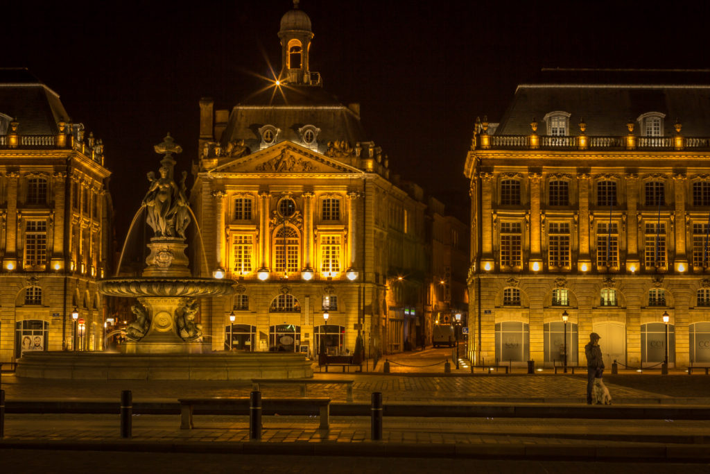 Night photo of a fountain and buildings at Place de la Bourse in Bordeaux, France
