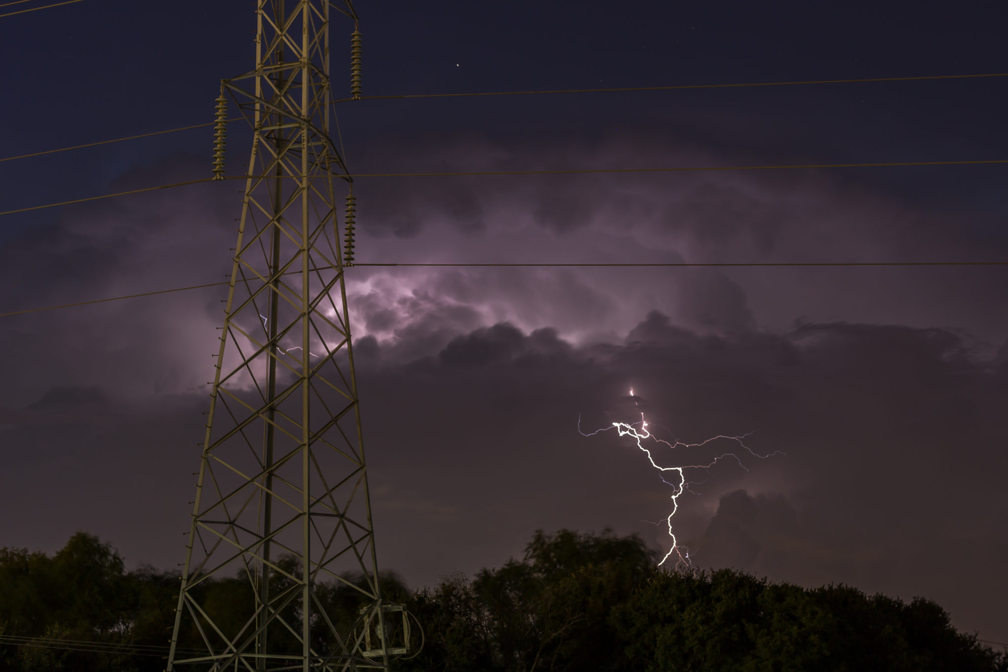 Austin, TX - The storm is coming... Photo of lightning in a purple dark sky